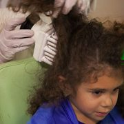 girl receiving airalle head lice treatment