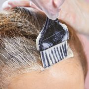 hair dye being applied to kill head lice