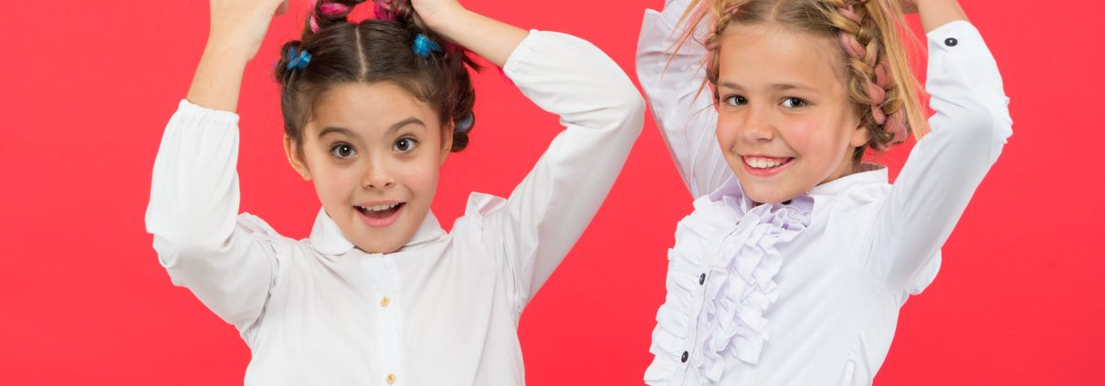 Young girls modeling the best hairstyles to prevent head lice.